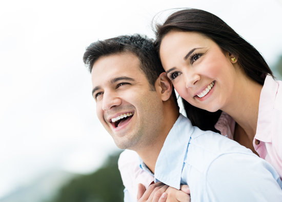 Portrait of a happy loving couple laughing outdoors