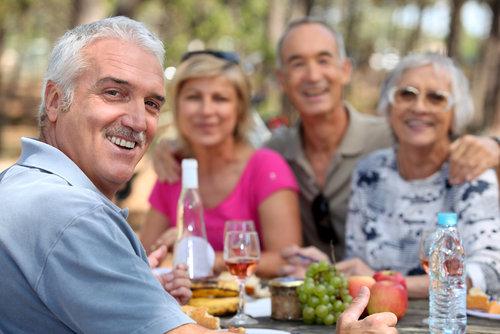 Older couples enjoying an alfresco lunch