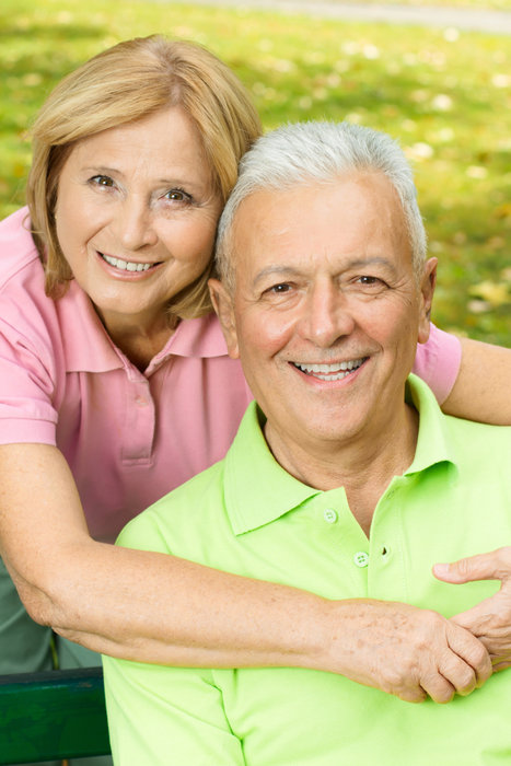 Closeup portrait of happy mature woman embracing elderly man.